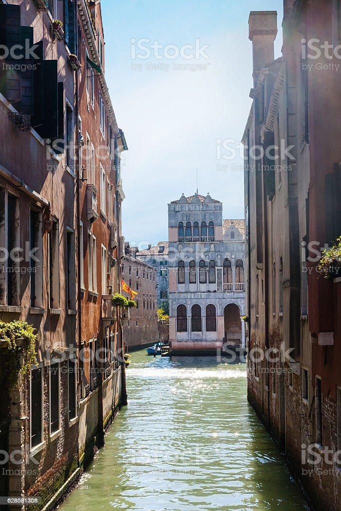 narrow canal in Venice city stock photo