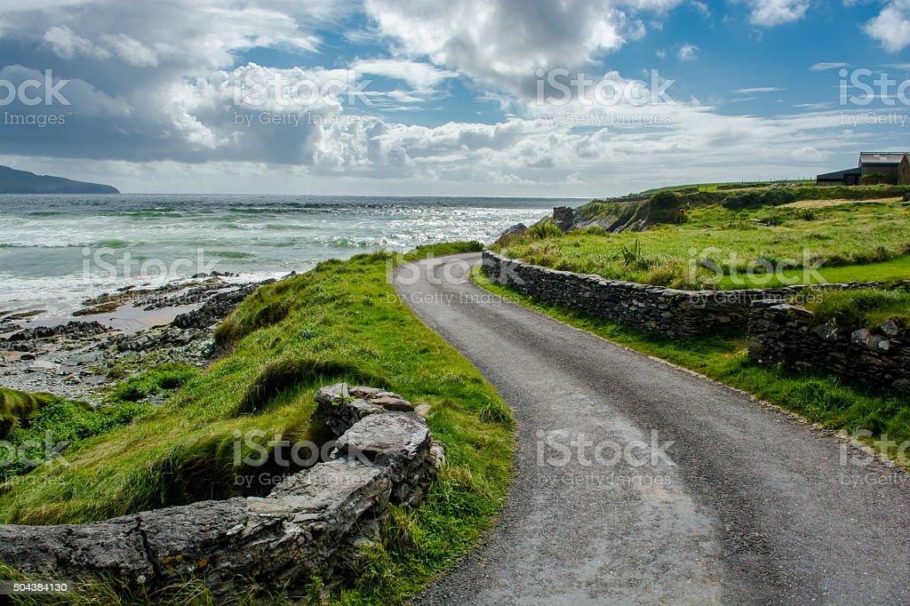 Narrow Coastal Road in Ireland stock photo