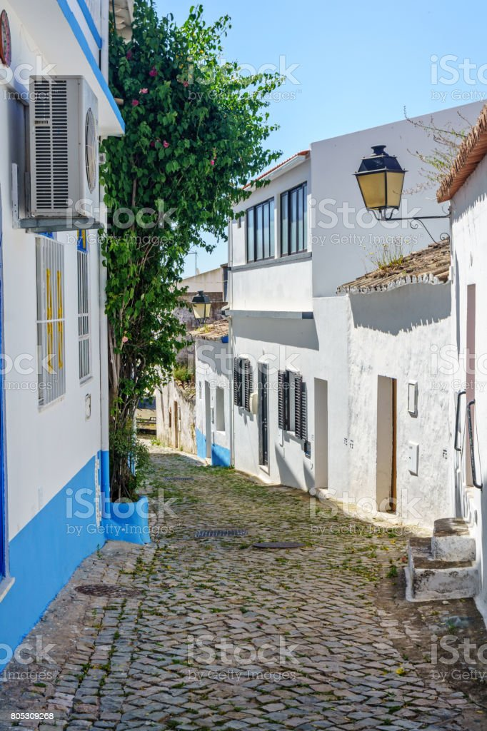 Narrow cobblestone street in Portugal stock photo