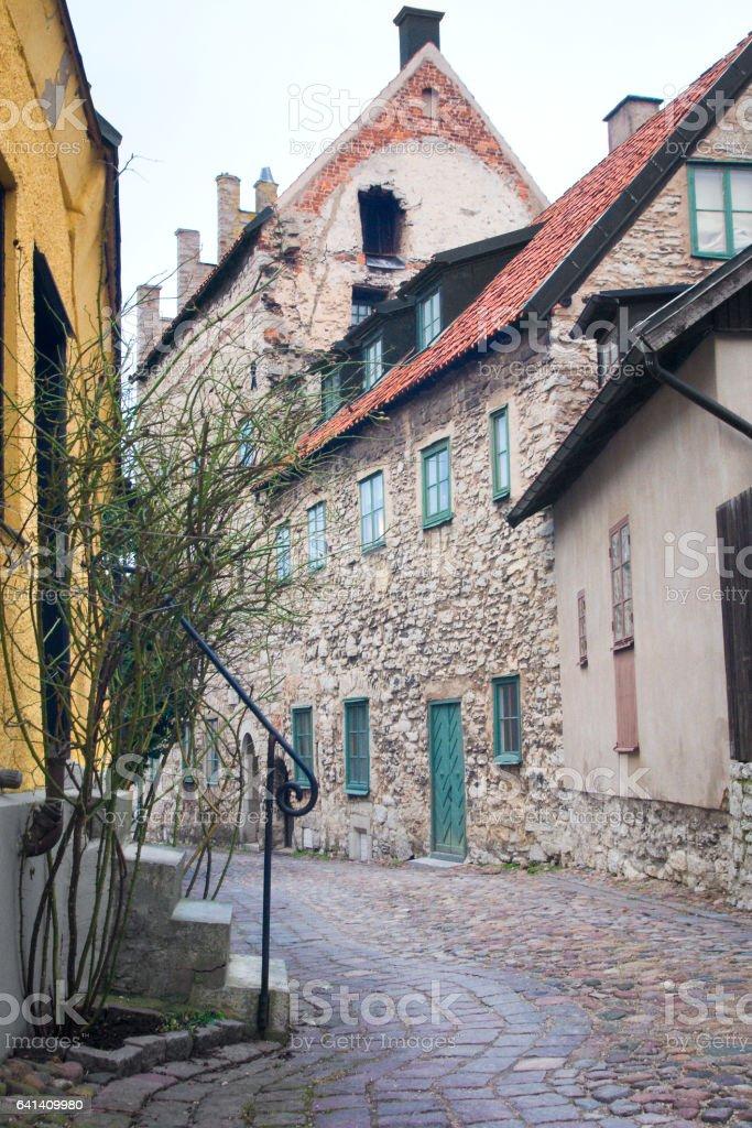 Narrow cobblestone street on Gotland Island stock photo