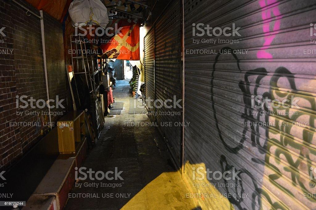 Narrow, dark alley in Kowloon, Hong Kong stock photo