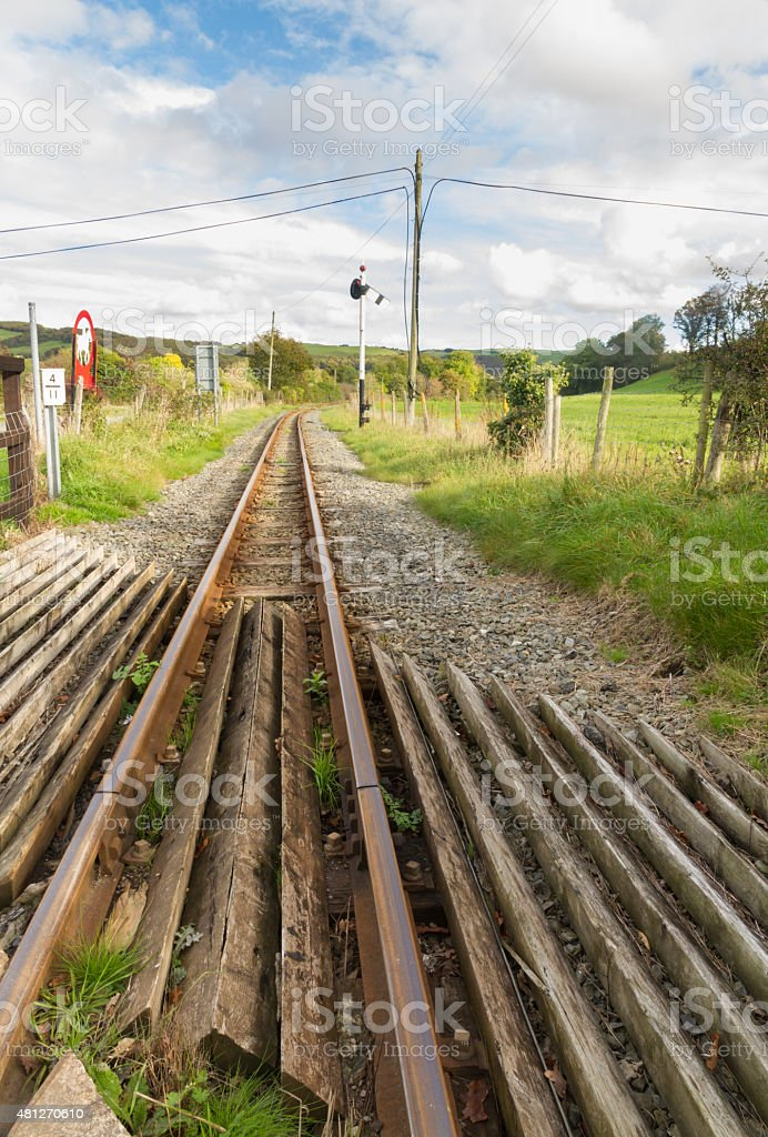 Narrow gauge railway or railroad track converging into distance stock photo