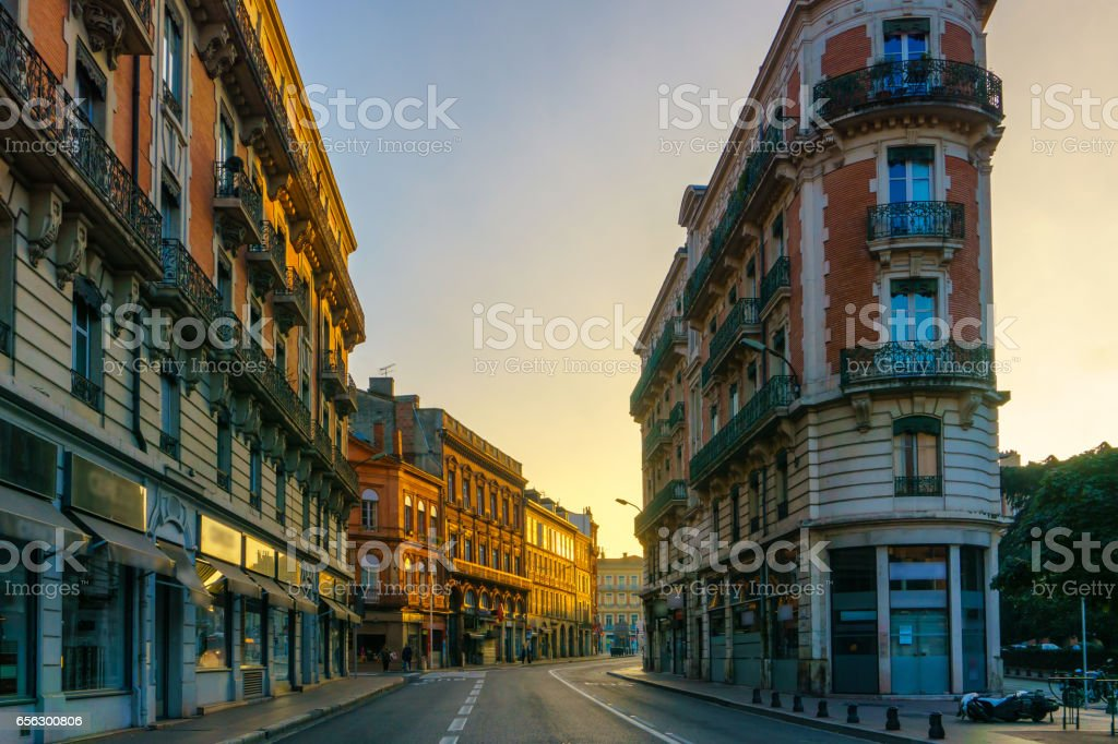 Narrow historic street with old buildings in Toulouse, France stock photo