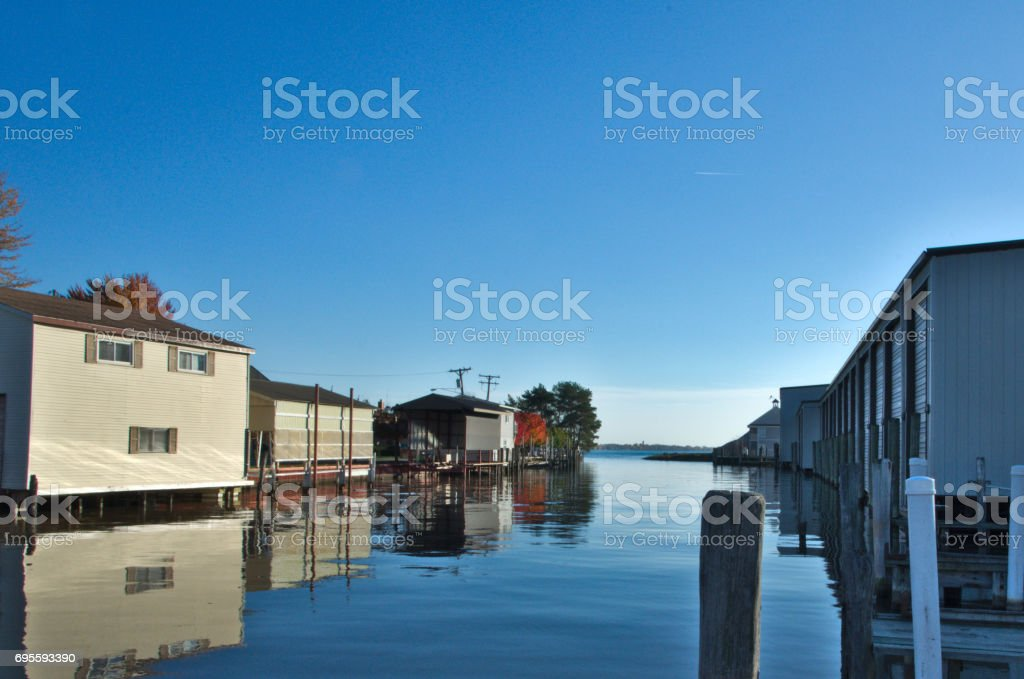 A narrow inlet provides sanctuary for small watercraft stock photo