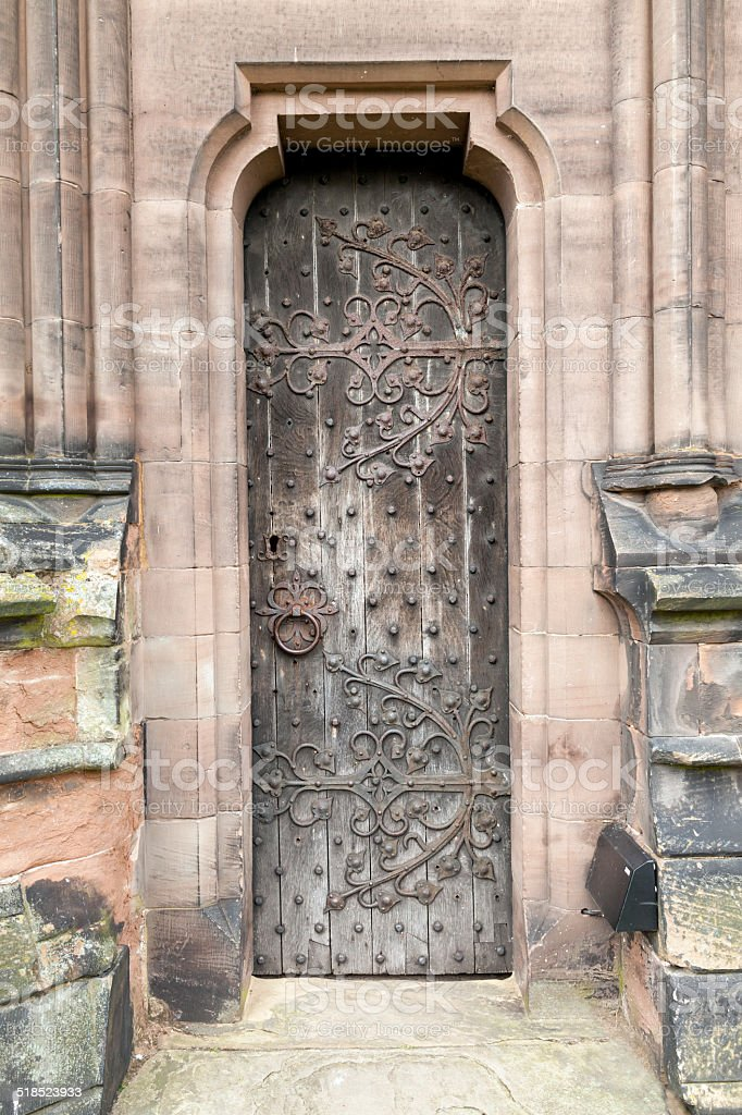 Narrow Medieval oak door stock photo