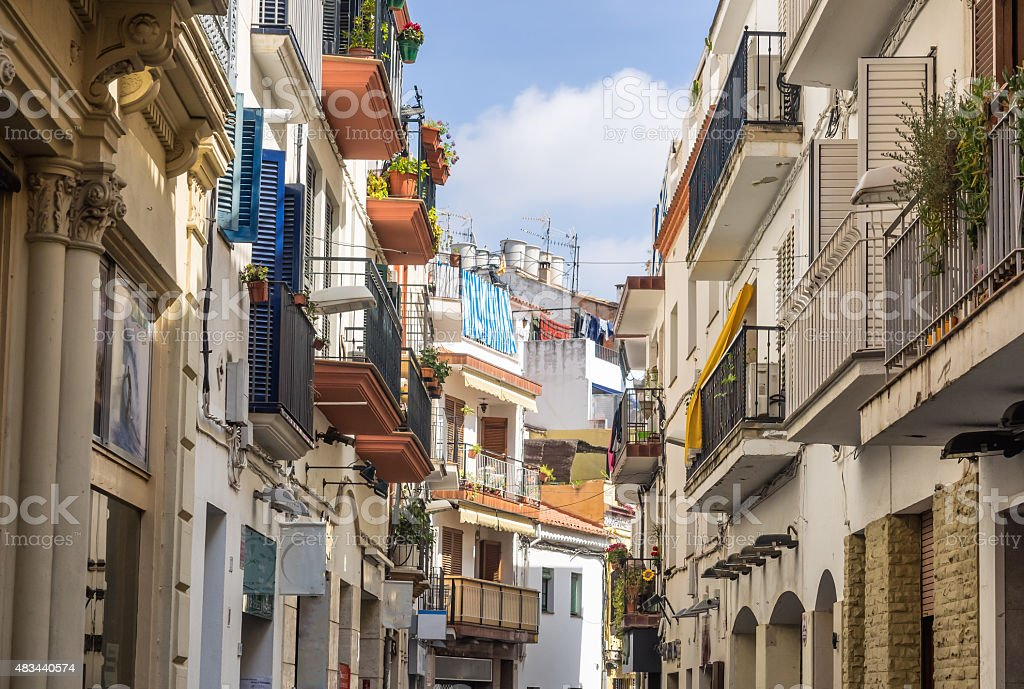 Narrow medieval street in Old Sitges, historical resort-city clo stock photo