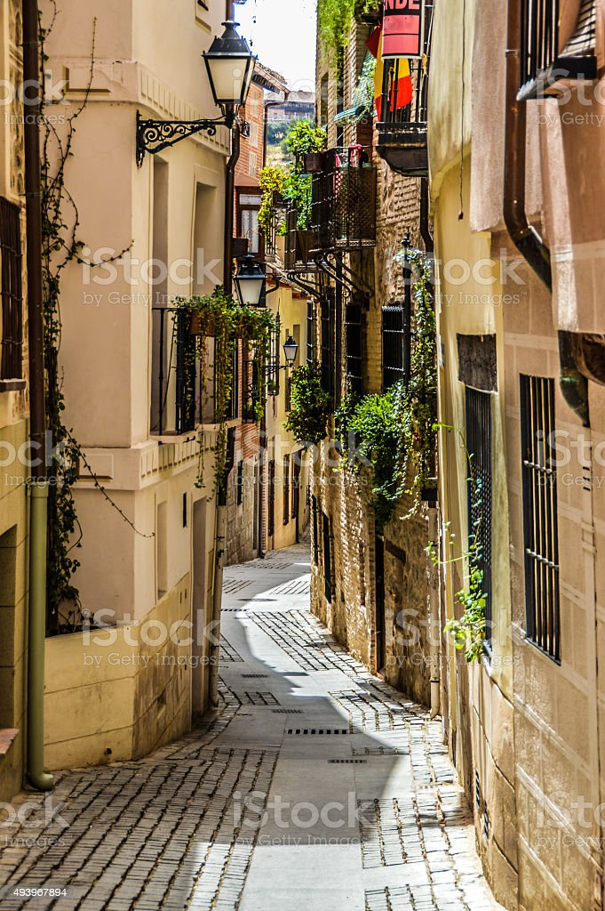 Narrow medieval street in Toledo, Spain stock photo