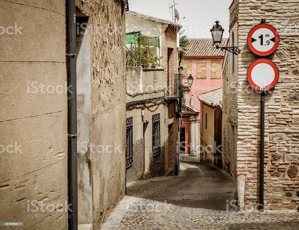 Narrow medieval street in Toledo, Spain stock photo