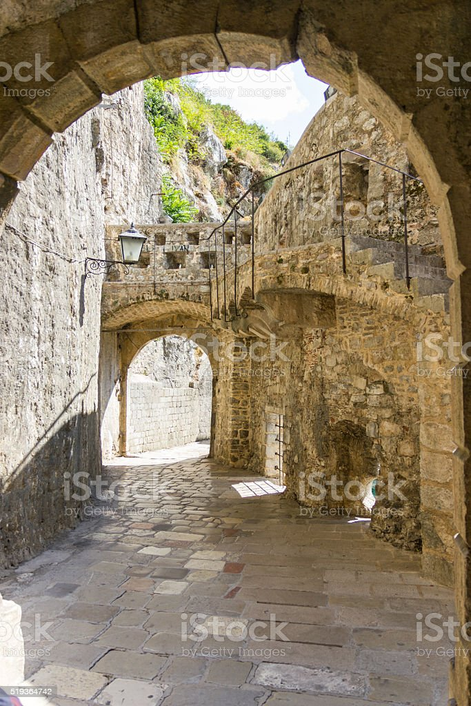 Narrow medieval streets of Old Town of Kotor. stock photo