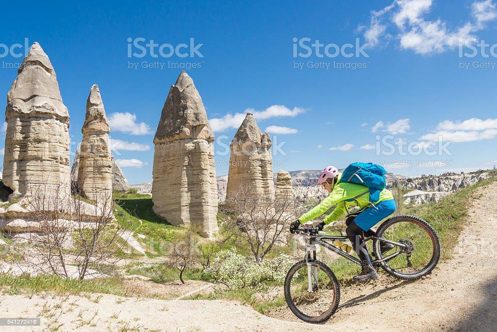 Narrow mountainbike turn in Cappadocian Landscape, Turkey stock photo