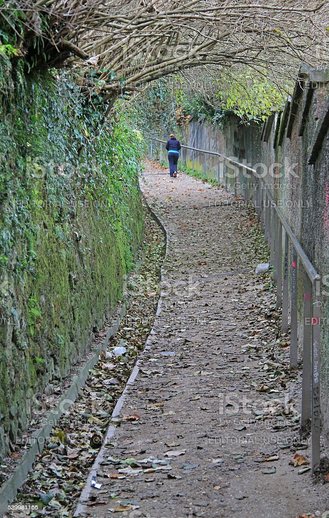 narrow pathway to up of the hill in Ljubljana stock photo