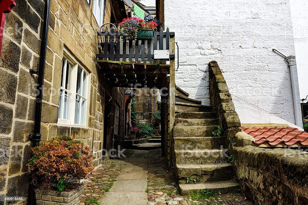 Narrow residential street and steps in Robin Hoods Bay, England stock photo