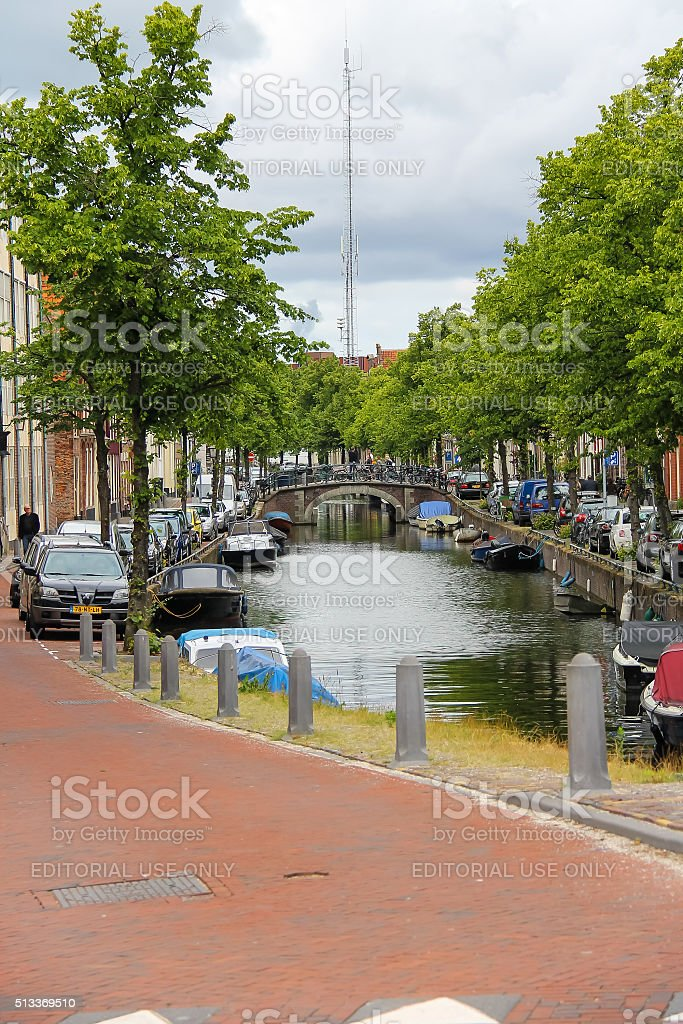 Narrow river channel in city centre of Haarlem, the Netherla stock photo