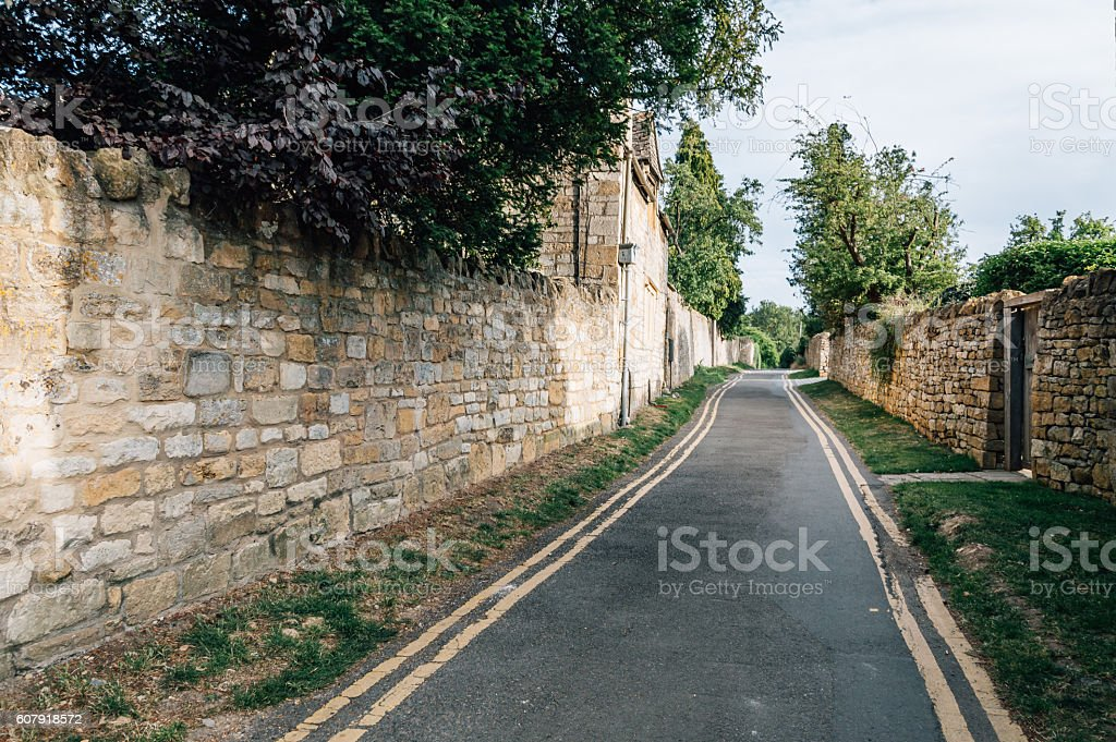 Narrow road in a village stock photo