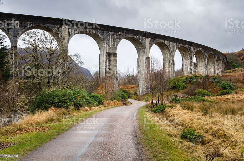 Narrow Road Passing under a Viaduct stock photo