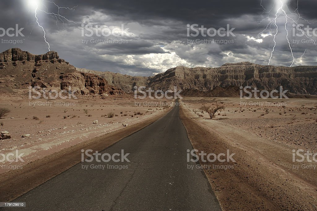 Narrow road through the desert in Israel. stock photo