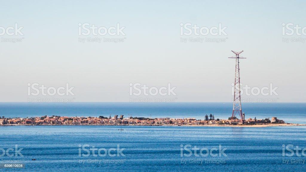 Narrow seashore with a city and antenna stock photo