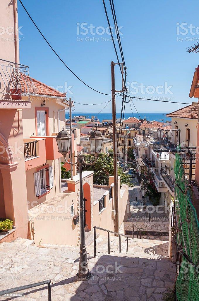Narrow sidewalk in Zakynthos city stock photo