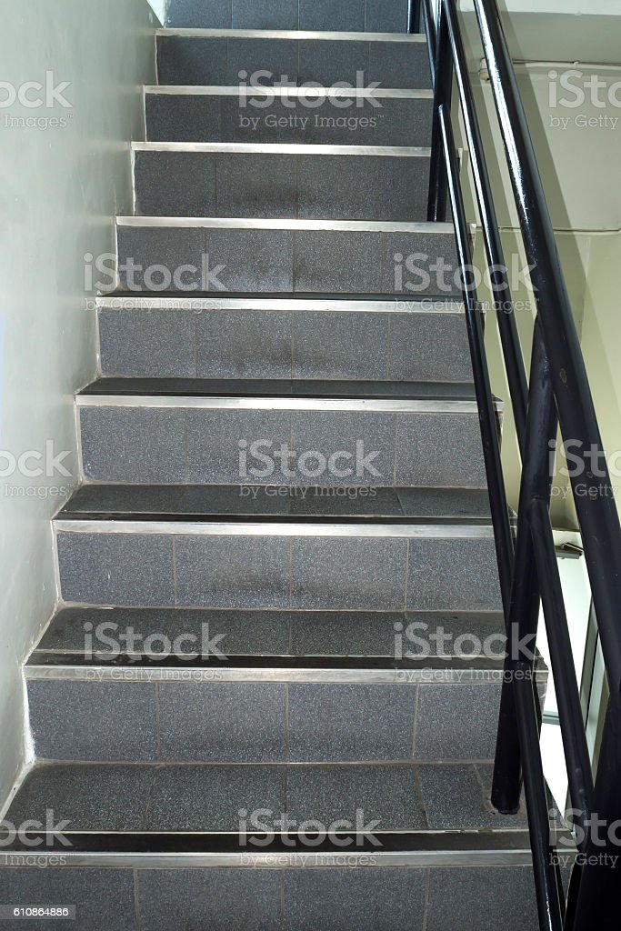 narrow stairs and metal rail. stock photo
