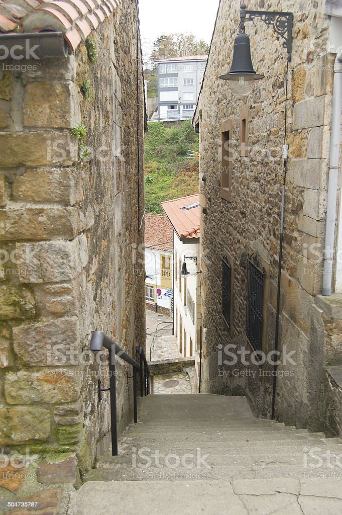 Narrow stairs on a stone street stock photo