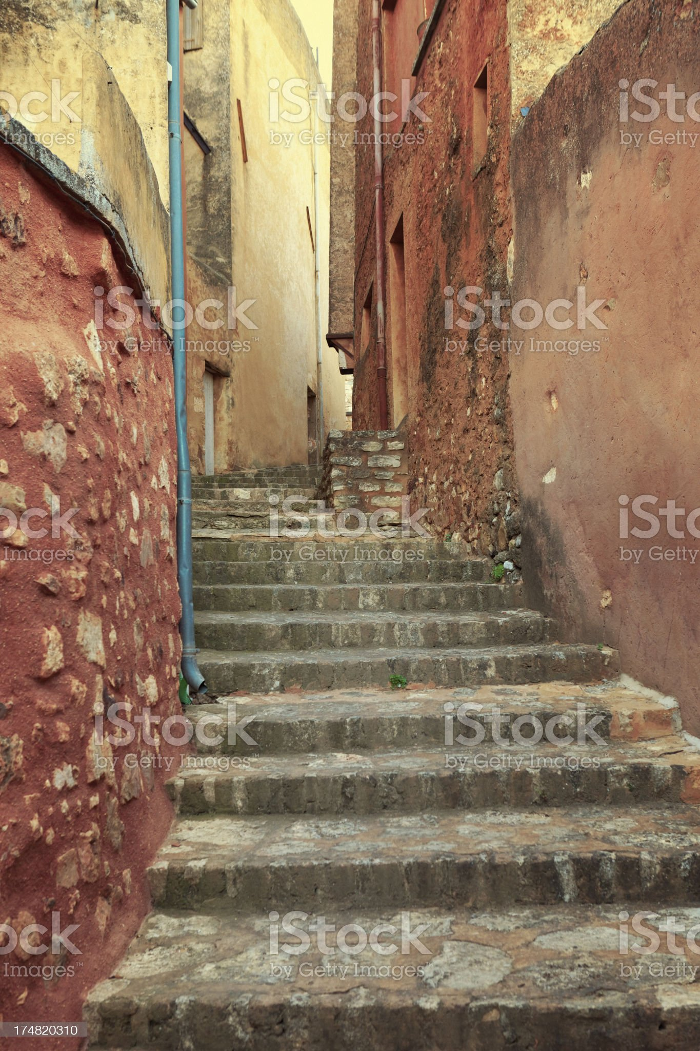 narrow stepped street in Roussillon, Provence, France royalty-free stock photo