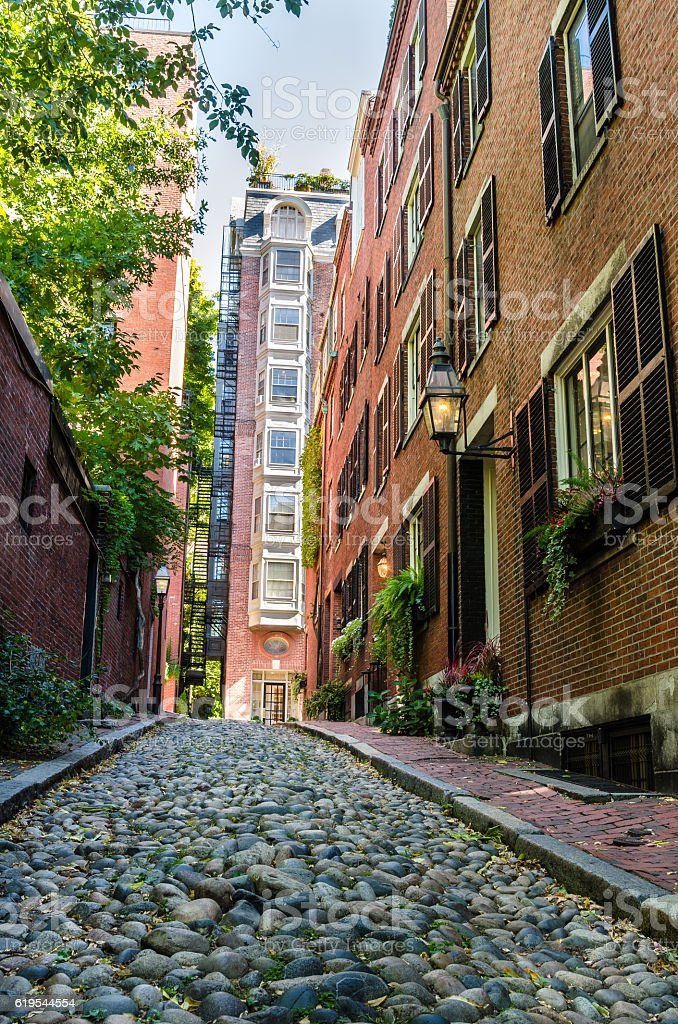 Narrow Stone Street Lined with Brick Buildings stock photo