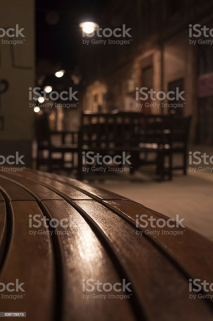 narrow street and a bench at night royalty-free stock photo