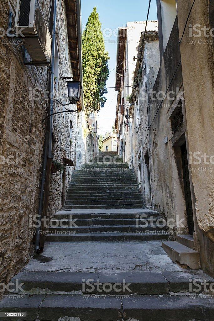 Narrow Street and Stairway in Pula, Croartia royalty-free stock photo