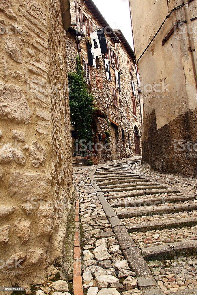 Narrow street between buildings (Narni, Umbria, Italy) royalty-free stock photo
