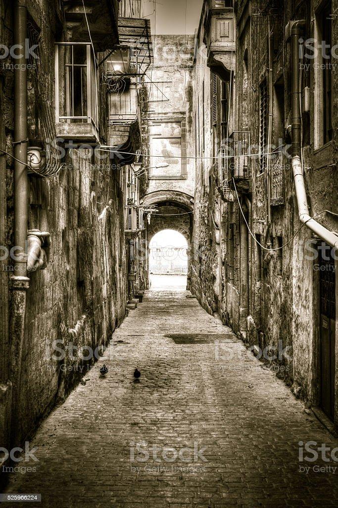 Narrow street HDR sepia dark tone stock photo