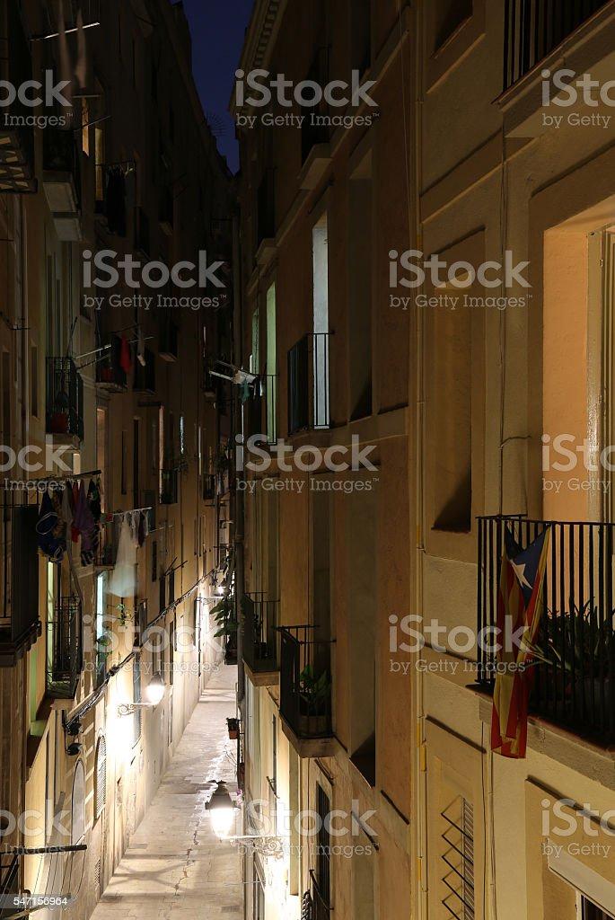 Narrow Street in Barcelona at Night stock photo