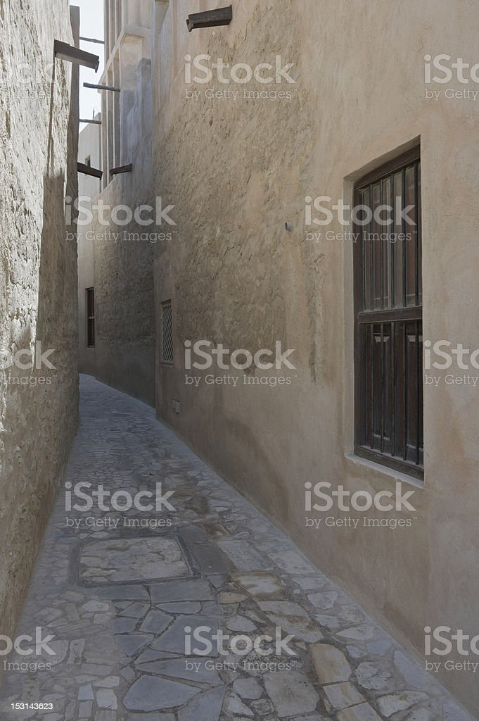 Narrow street in Bastakia Quarters in old Bur Dubai royalty-free stock photo