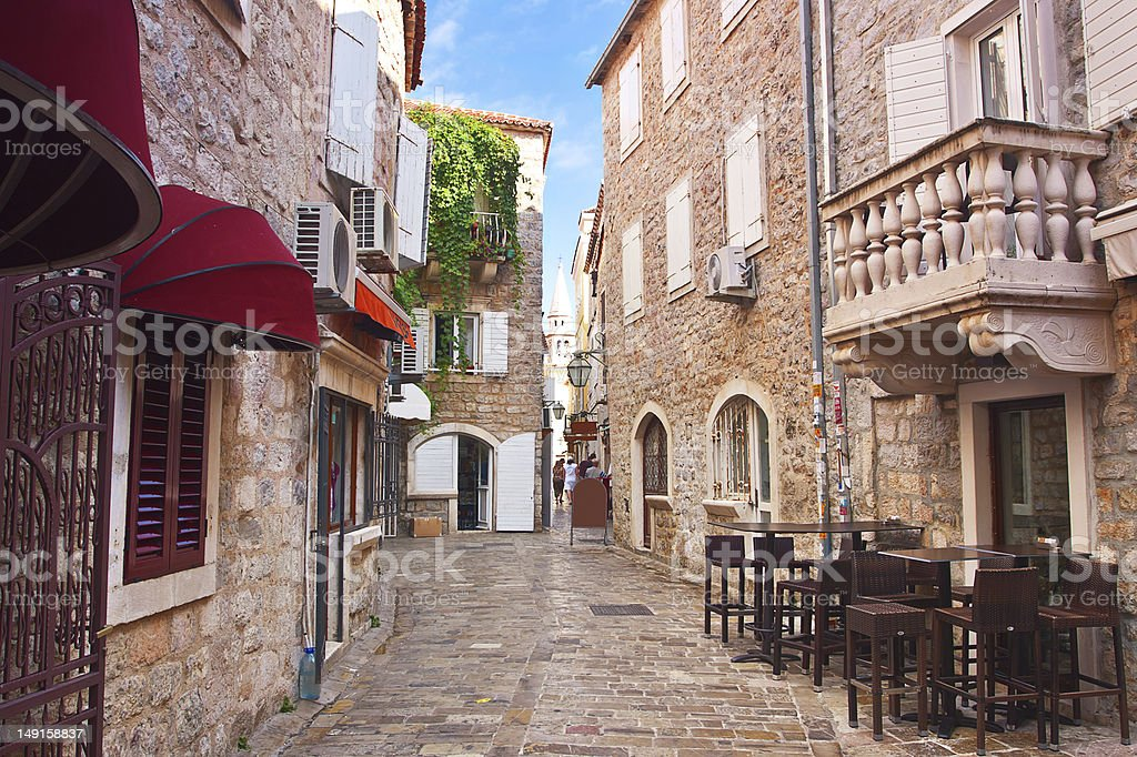 narrow street in old district of Budva stock photo