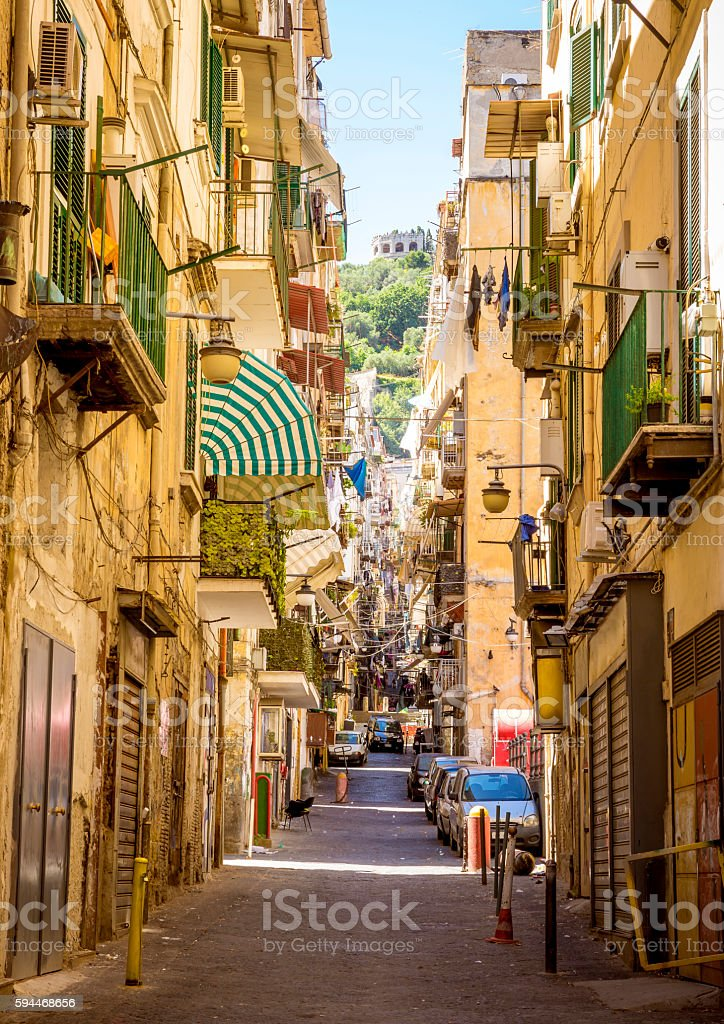 Narrow street in old town of Naples city in Italy stock photo