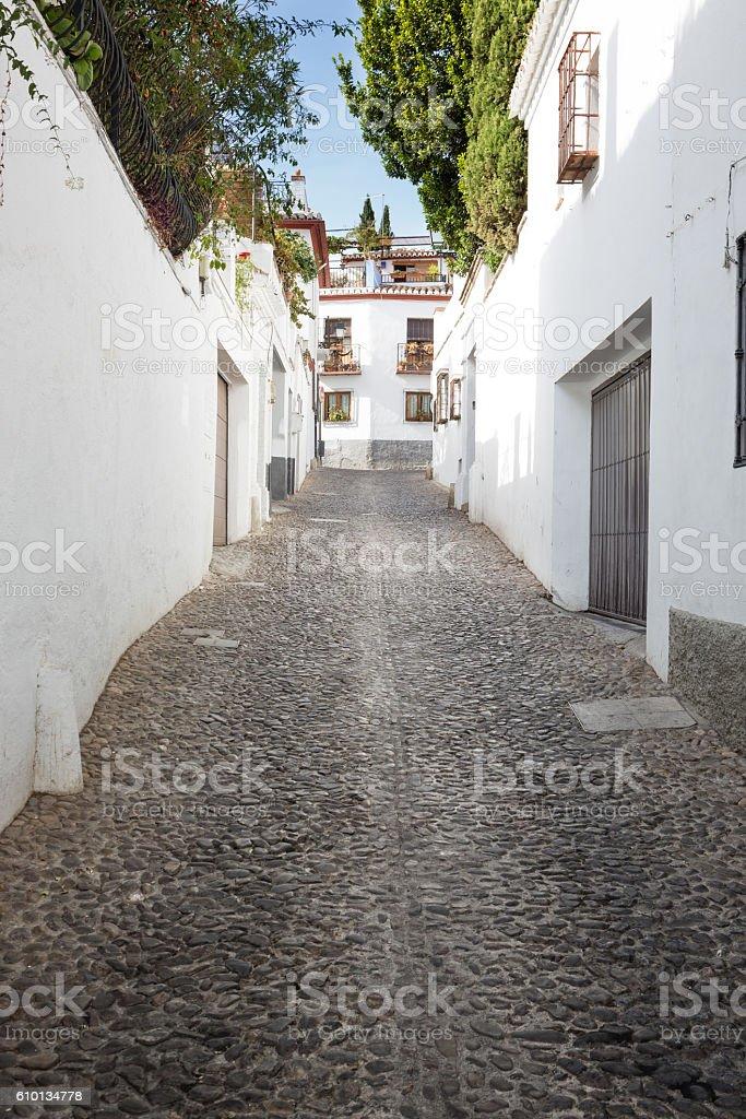 Narrow street in the Albaicín area, Granada, Andalusia, Spain stock photo