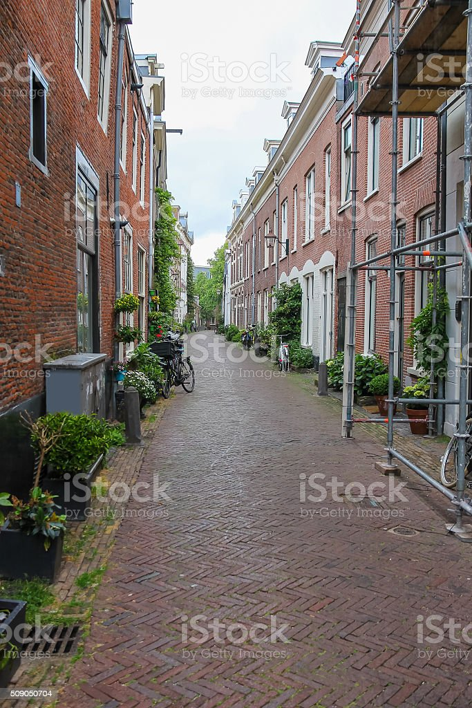 Narrow street in the  historic center of Haarlem, the Netherlands stock photo