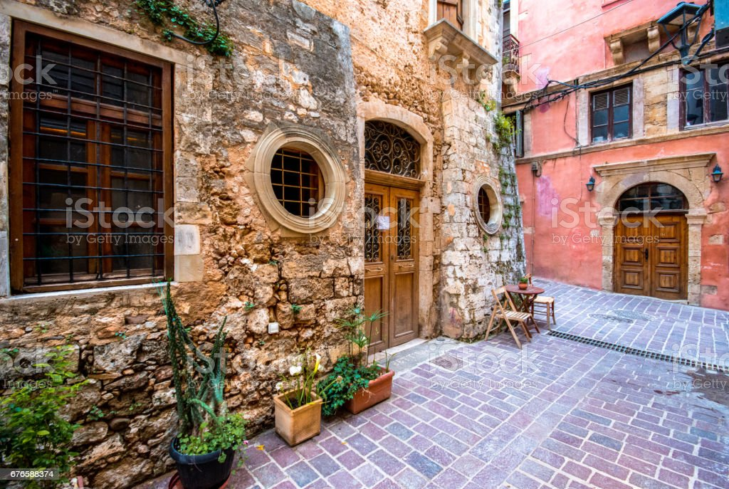 Narrow street in the old town of Chania, with colorful buildings, Crete, Greece stock photo
