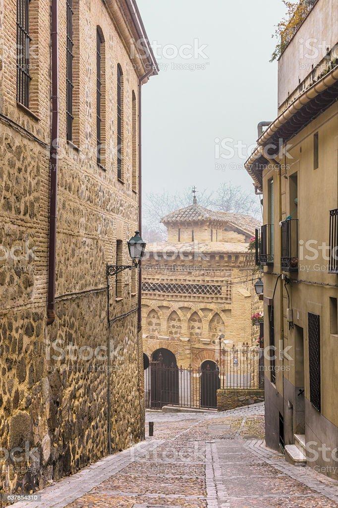 Narrow street in Toledo, Spain, in foggy weather stock photo