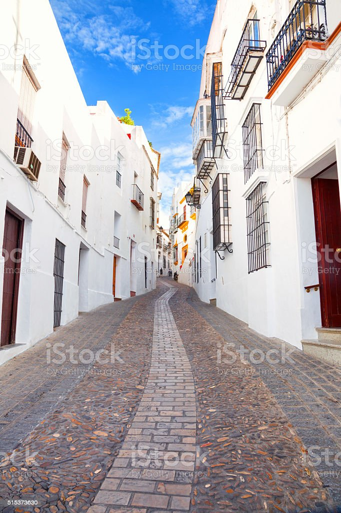Narrow street of Arcos de la Frontera, Spain stock photo
