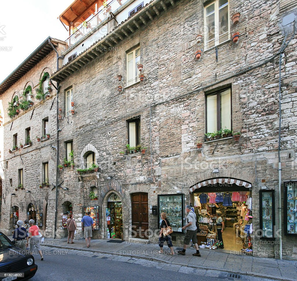 Narrow Street, Stores, Tourists and Stone Buildings, Assisi, Umbria, Italy. stock photo