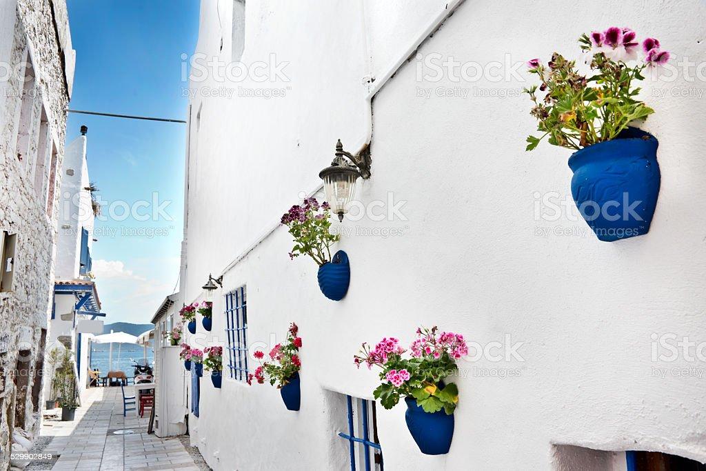 Narrow street, the mediterranean sea in the background, Bodrum, Turkey stock photo