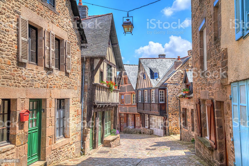 Narrow street with old traditional houses in Dinan stock photo