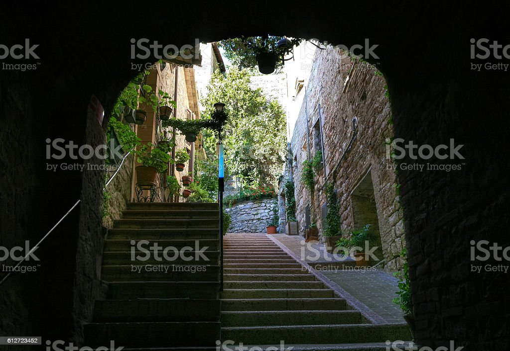Narrow Street with Stairs, Historic Part of Assisi, Umbria, Italy. stock photo