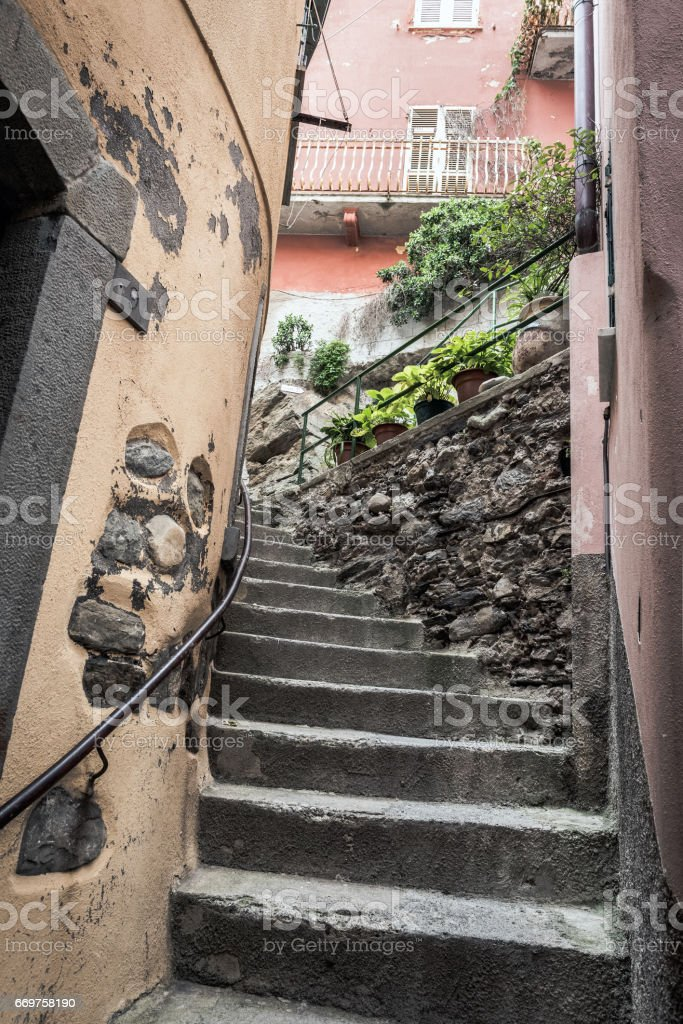 Narrow street with stairs in Vernazza town, Italy stock photo