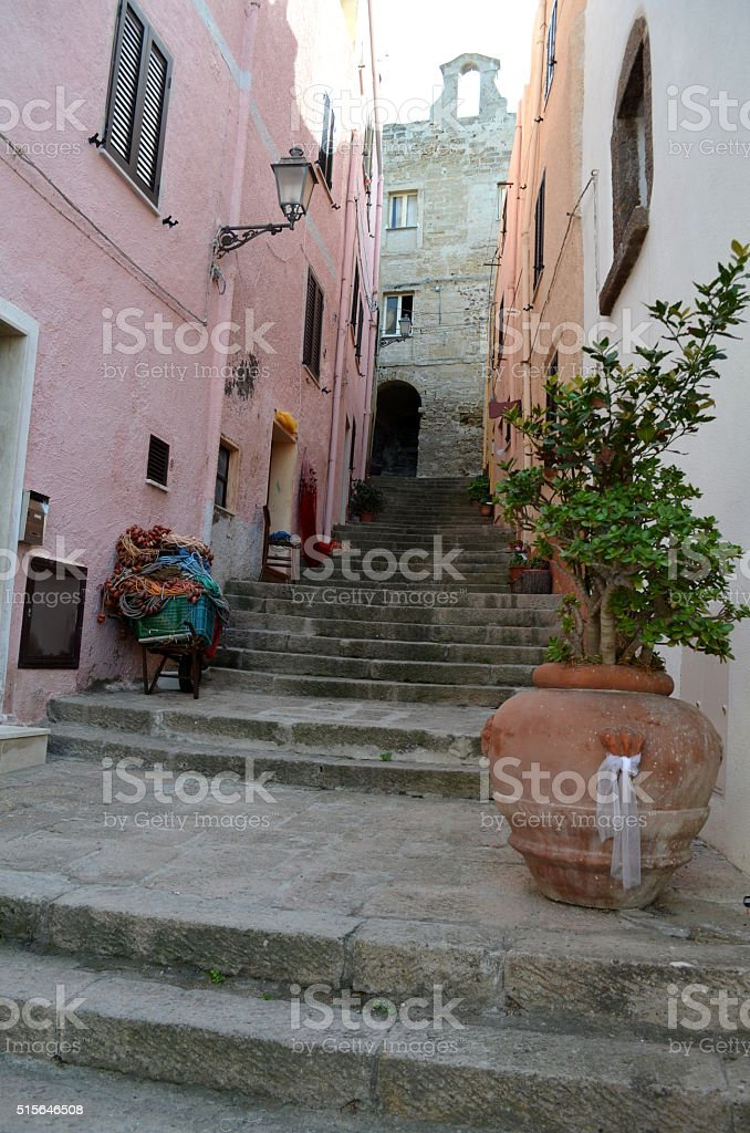 Narrow street with steep stairs leading up the hill stock photo