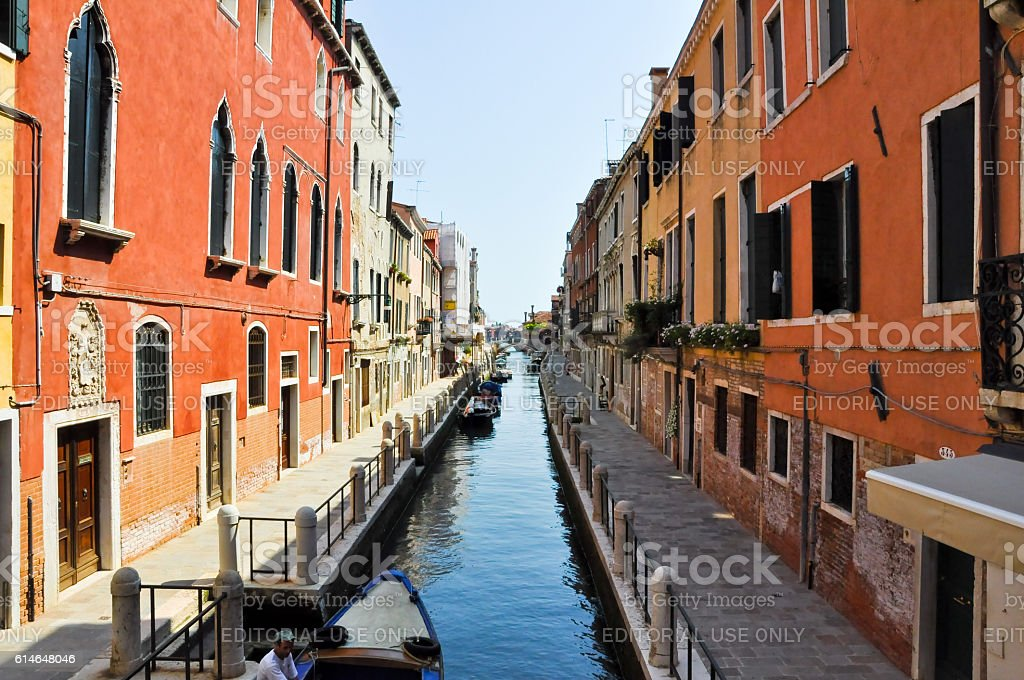 Narrow Venetian canal during the midday in Venice, Italy. stock photo