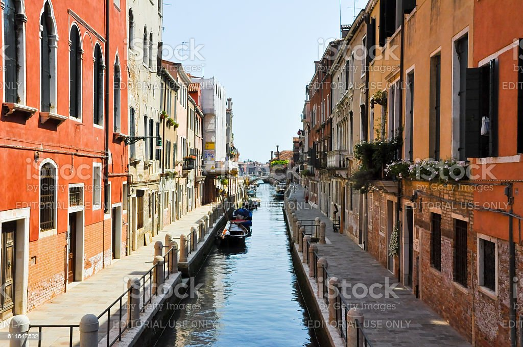 Narrow Venetian canal in Venice, Italy. stock photo