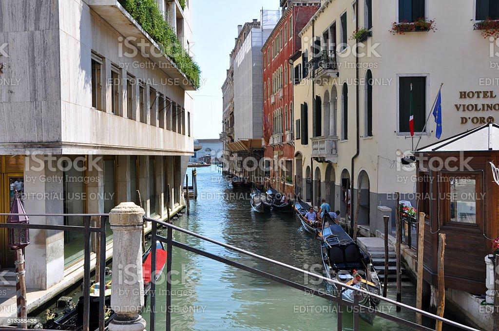 Narrow Venetian canal with gondolas in Venice, Italy. stock photo