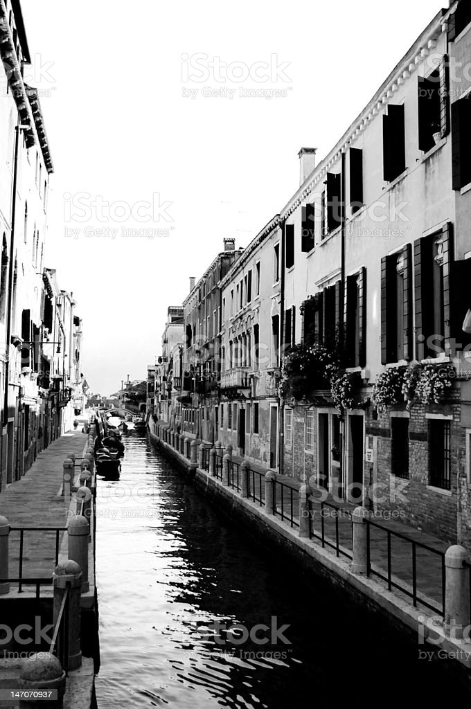 Narrow Venice Canal in black and white royalty-free stock photo