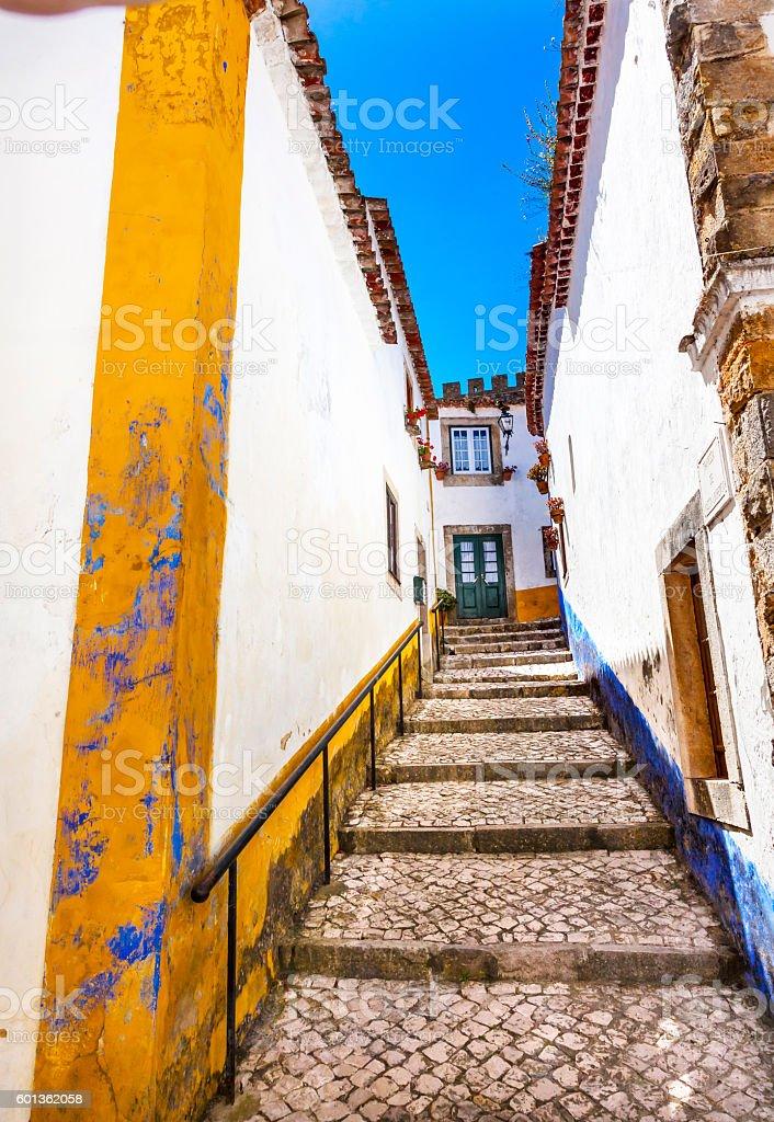 Narrow White Street 11th Century Mediieval City Obidos Portugal stock photo